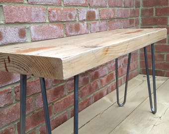 Character filled reclaimed wood coffee table with steel hairpin legs