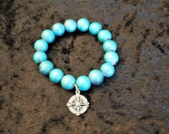A Blue Glass Beaded Bracelet with a Charm
