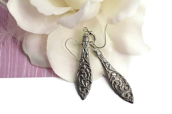 Long dangle steel earrings, leaf style earrings