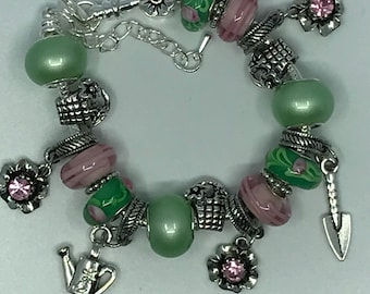 Garden themed charm bracelet in pink and green