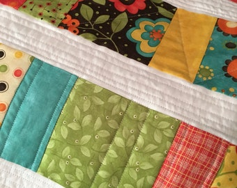 Baby quilt -- small stroller quilt -- pieced and quilted on a home sewing machine