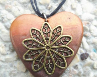 Rose heart necklace made of polymer clay.