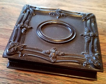 A. P. Critchlow union case with photo. Gutta percha. Daguerreotype Case. 1856 patent. APC & Co. Victorian photo. Thermoplastic. Small chip.