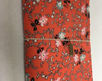 Fabric journal cover for composition notebook. Oriental style fabric in orange, black with flowers