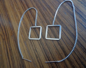 Square frame, silver earrings.
