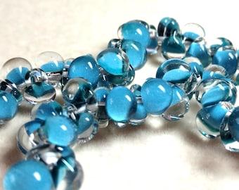 Unicorne Teardrop, Boro Glass, Color: 1263, Dark Sky Blue, Strand of 25 beads