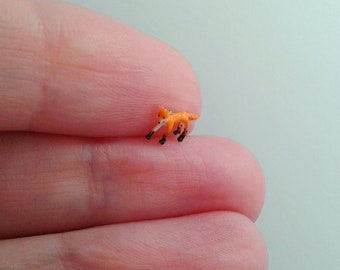 Extremely tiny fox figurine.