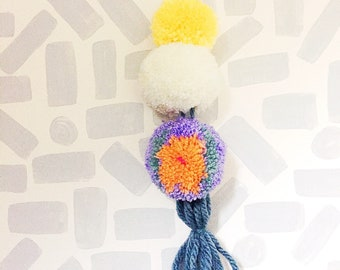 Pom pom tassle hanging decor to give that pop of colour