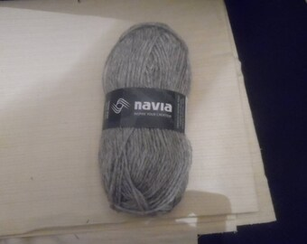 1 skein of Navia Trio 100% pure Australian/Shetland/Faroese new wool 120m per 50g skein   Color is gray  #32