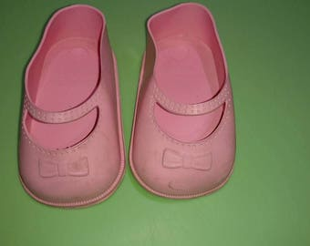 BABY DOLL,30T pink flexible plastic,baby doll  SHOES,used,large made in the usa