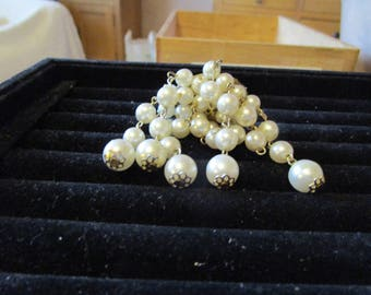 """vintage oval goldtone back with 10 lengths faux pearls on chains 1.25""""across 3""""drop"""