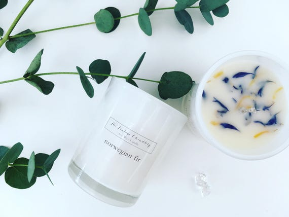 Boutique white votive soy candle finished with dried flora in a white organza pouch