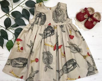 Girls pretty hare, toadstool, woodland print cotton dress. 0-6 years.