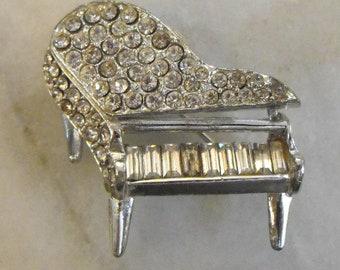 Rhinestones on Silvertone Piano Brooch by PELL
