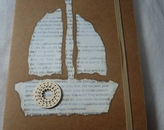 Notebook with cover bound and decorated with a boat