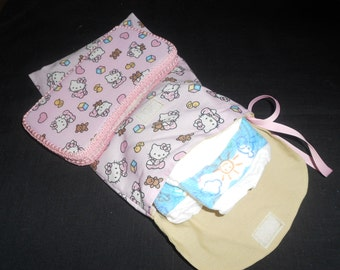 Diaper clutch with matching wipe case.