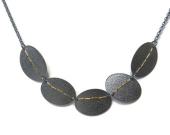 Oxidised Silver oval 5 disc necklace stitched with gold thread