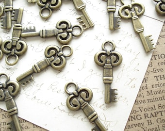 Skeleton Key Charms. 12 Antiqued Brass Vintage Style Small Key Stampings. Steampunk, Jewelry, Scrapbooking, Crafts, Destash Supplies Sale.