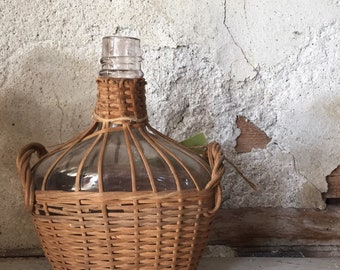 Small wicker demijohn bottle
