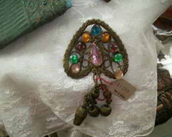 Antique metal appliqué with beautiful inset jewels authentic flapper