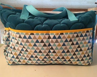 New diaper velvet bag is quilted and graphic fabric.