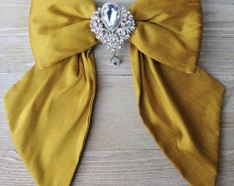 Golden Silk crib bow with Rhinestone Brooch embellishment