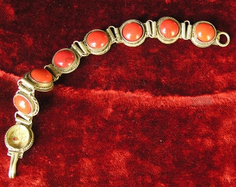 Brass and red cabochon bracelet