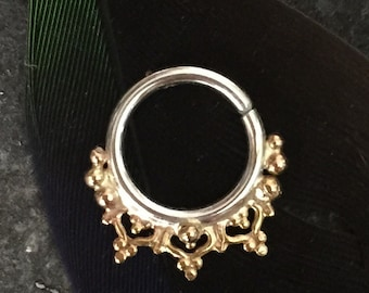 Silver and gold septum ring. Heart and ball detail