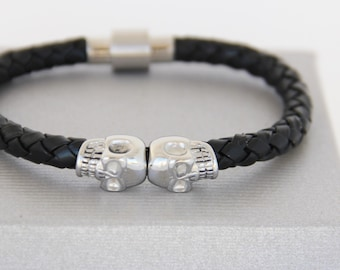 Human skulls braided leather and steel bracelet. BLACK REBEL