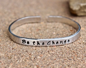 Proceeds Go to Charity of Your Choice - Be the Change Cuff Bracelet in Aluminum - 20 dollars of this sale go to charity of your choice