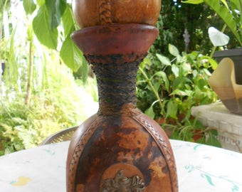 RARE vintage Original M A Leather covered green  glass wine Decanter/Made in Italy/the same court of arm on four sides.