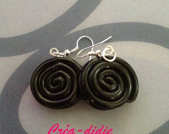 Black licorice candy earrings.