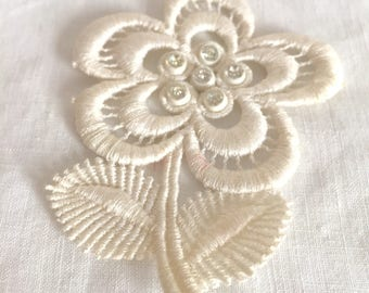 Vintage white appliqué flowers two in total.