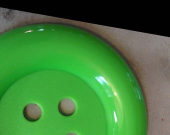 Large green plastic decorative button