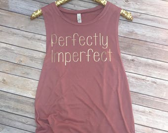 Perfectly imperfect flowy muscle tank.