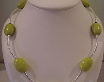 Simple green necklace and silver tube