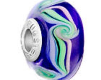 This .925 Sterling Silver bead was made by Murano for Pugster and says Pugster on the side as seen in the picture.