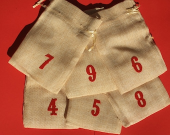 24 pockets or pouches braided mesh type burlap with numbers 1 to 24 for advent calendar