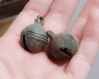 Set of 2 antique brass jingle bells, charms. Black patina of time. Ringing