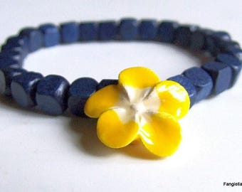 Beautiful yellow porcelain flower by Lysa and accompanied by blue wooden cubes
