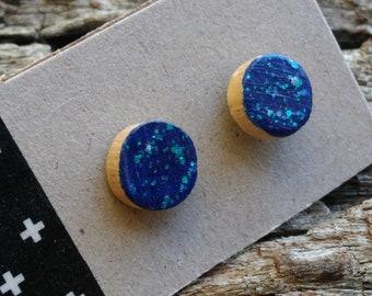 Handcrafted Tasmanian oak stud earrings in marine blue.