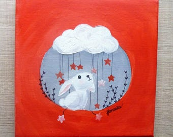 small canvas rabbit under the cloud with stars