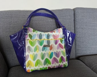 Spring Tulips Celine tote style handbag, with high glass purple vinyl, iridescent hardware and strap and zipper closure