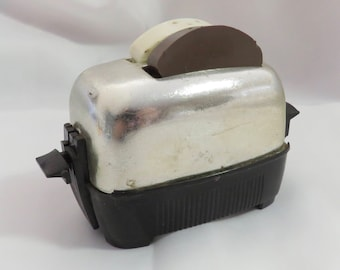 Vintage Plastic and Ceramic Novelty Toaster and Toast Mechanical Salt and Pepper Shakers