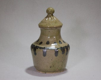 Elegant Loden green and black jar with carved lid