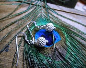 Stardust earrings. Sterling Silver diamond cut swirly simple ball dangle earrings