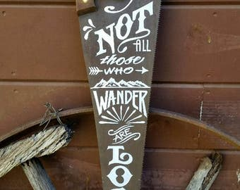 Not all those who wander are lost.  J.R.R. Tolkien quote.  Hand lettered on a vintage Henry Disston Saw.  Subway Art.