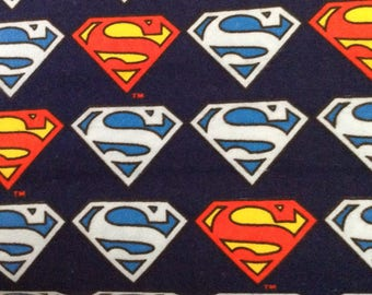 Flannel/Licensed/Superman emblem on navy blue background cotton by the yard