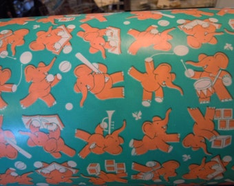 Vintage Gift Wrapping Paper, Elephants in aqua and orange, playing sports for sale at Estate ReSale &ReDesign, LLC in Bonita Springs, FL