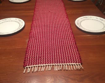 Handwoven table runner in a deep red/maroon color